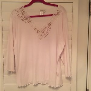 white tee with 3/4 length sleeves. Tan design